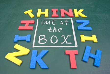 Think out of box, colorful words on blackboard. photo