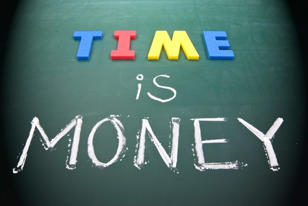 Time is money, business words on blackboard. Stock Photo - 9405898