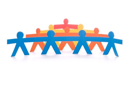Concept of teamwork, colorful paper dolls chain on white background Stock Photo - 9405893