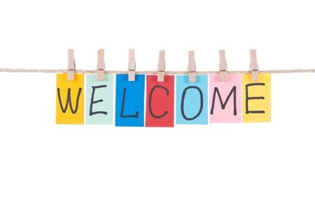 bienvenidos: Palabras bienvenida, papel tarjeta se bloquea por clavija de madera