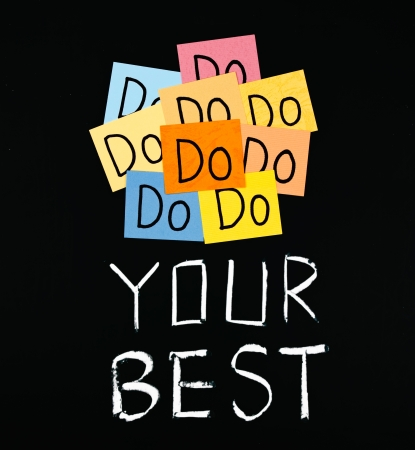 encouragement: Do your best, paper cards and words on blackboard.  Stock Photo
