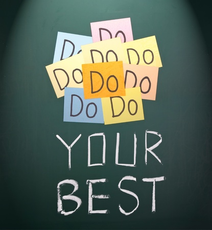 best ideas: Do your best, paper cards and words on blackboard.  Stock Photo