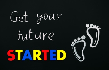 Get your future started with footprint. Colorful words on blackboard photo