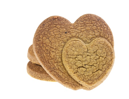 Isolated cookies with two connected heart pattern on white background. Made up of chocolate. photo