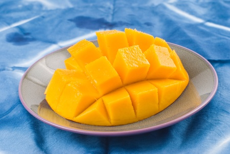 Fresh delicious mango fruit in dish, tropical fruit. photo