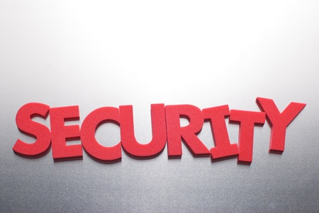 security company: security word on metal background, part of a series of business words Stock Photo