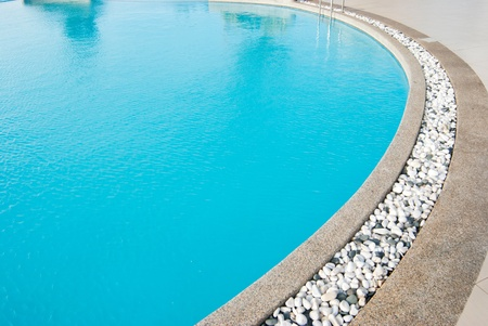 Swimming pool with white pebbles in edge photo