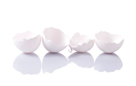 Group of eggshells with reflection on white background Stock Photo - 10286844