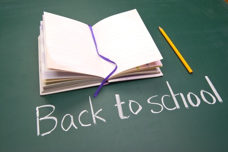 Back to school words, Book and pencil on blackboard. Stock Photo - 10358556