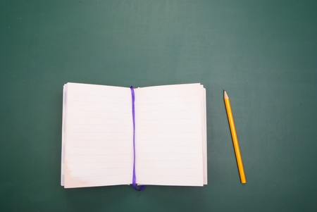 Back to school words, Book and pencil on blackboard. Stock Photo - 10363056