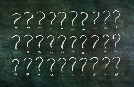Drawing question marks group on old grungy blackboard. photo