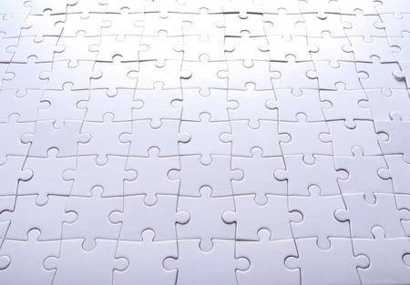 Puzzle background. Blank puzzle in pieces. Reklamní fotografie