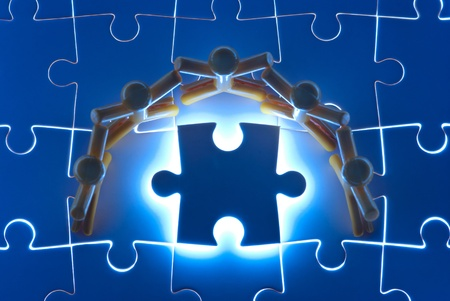 Team work on solving puzzle problem. Team work concept. Stock Photo - 10864000