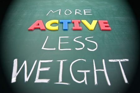 action plan: More active less weight, healthy concept on blackboard.