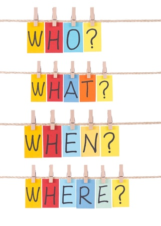 who: Who, what, when, where, colorful words hang on rope by wooden peg Stock Photo