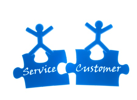 rise to the top: Right service to customer. Two people rise hands and stand on  top of puzzles.