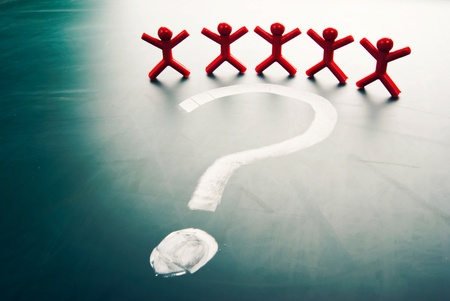 uncertainty: Business team face a big question mark. Stock Photo