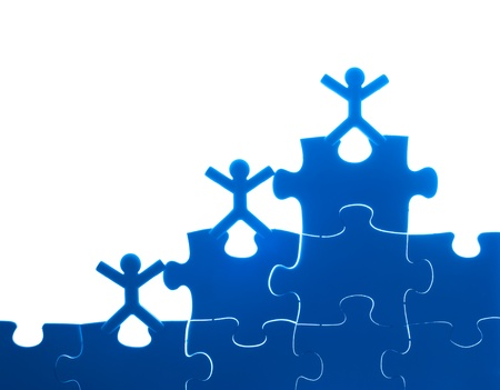 people puzzle: Team work on solving puzzle problem. Team work concept.