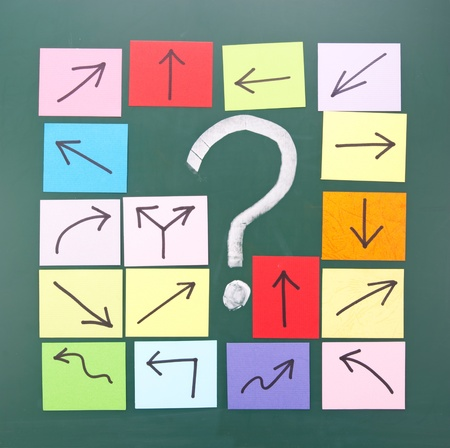 Question mark and colorful paper with different direction. Stock Photo - 11015944