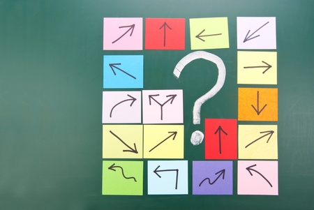 Question mark and colorful paper with different direction. Stock Photo - 11015947