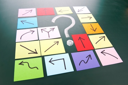 Question mark and colorful paper with different direction. Stock Photo - 11015953