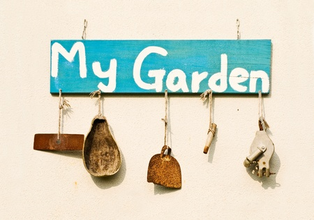 garden tool: Old gardening tools as decoration hang on white wall.