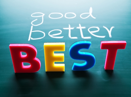 best guide: Good, better and best, colorful words on blackboard  Stock Photo