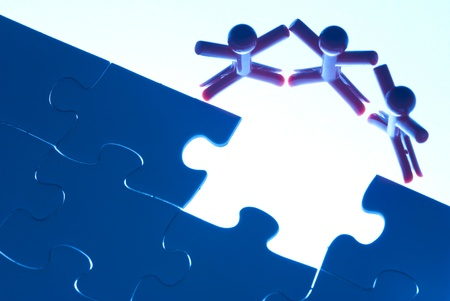 Team work on solving puzzle problem. Team work concept. Stock Photo - 11742438