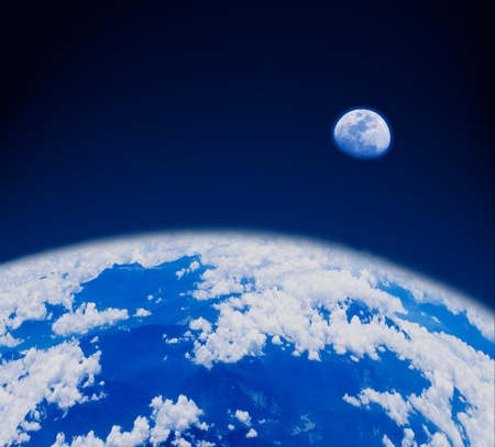 blue earth and moon in space. The earth with mountains and clouds.  photo