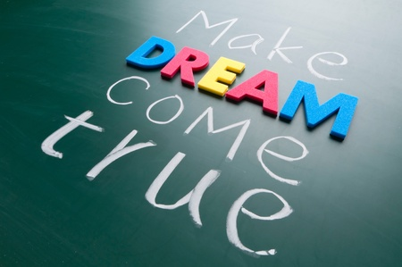come on: Make your dream come true. Colorful words on blackboard. Stock Photo