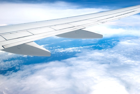 airfoil: Airplane fly above cloud and land Stock Photo