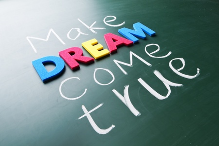 dream vision: Make your dream come true. Colorful words on blackboard. Stock Photo
