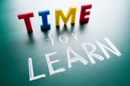 learn: Time for learn, colorful words on blackboard.