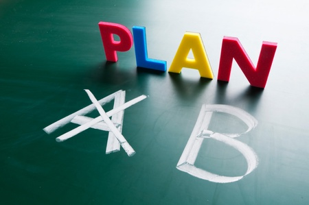 Crossing out Plan A and writing Plan B. Stock Photo - 11977131