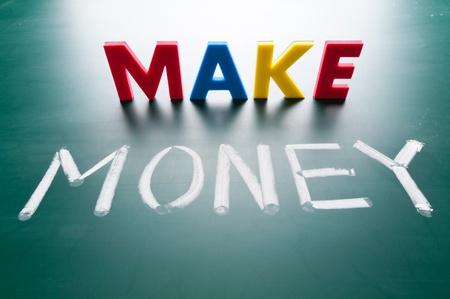 make money: Make money concept, message words on blackboard Stock Photo