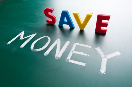 earn money: Save money concept, message words on blackboard Stock Photo