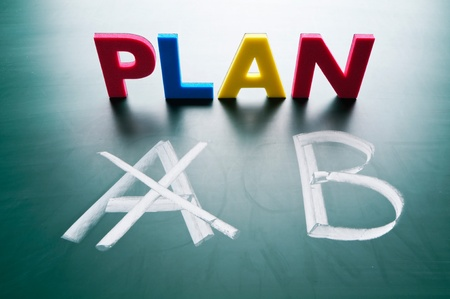 Crossing out Plan A and writing Plan B. Stock Photo - 12614792