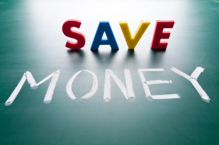 Save money concept, message words on blackboard photo