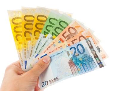 dinero euros: Los billetes en la mano, aislados en fondo blanco Foto de archivo