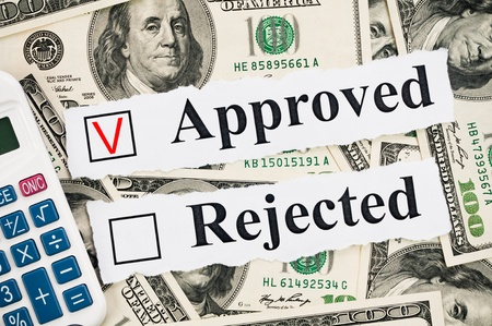 approval button: Financial approved or rejected concept, words and calculator on hundreds US notes background