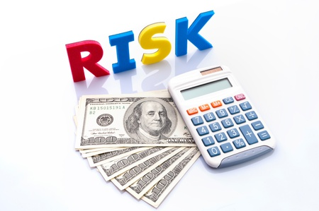 Risk words, American banknotes and calculator on white background