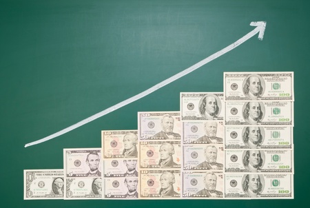 American banknotes and growing arrow on blackboard photo