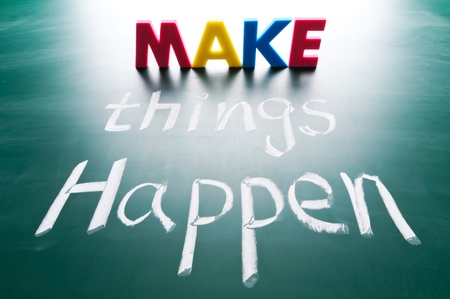 Make things happen, concept words on blackboard Stock Photo