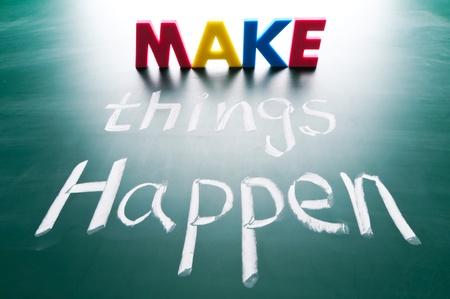 Make things happen, concept words on blackboard 版權商用圖片