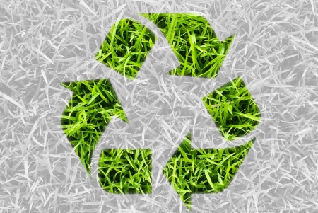 Recycle for green nature, recycle symbol by fresh grass leaves. photo