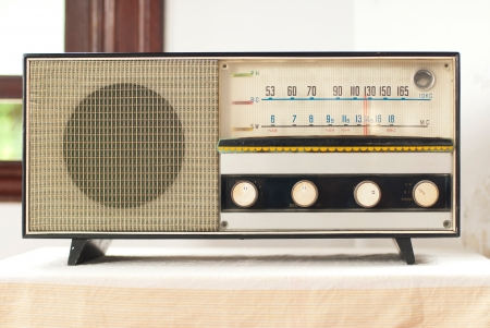 Old retro fashionable radio on the table photo