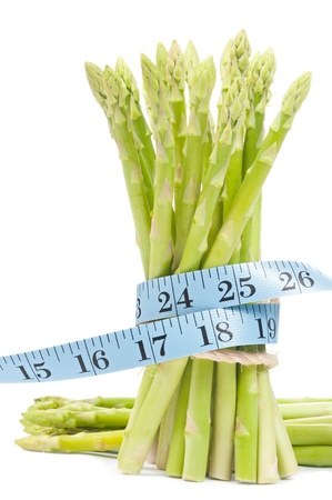 Lose weight concept  Isolated green Asparagus bundle with tape Stock Photo - 12615151
