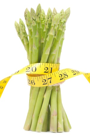Lose weight concept  Isolated green Asparagus bundle with tape photo