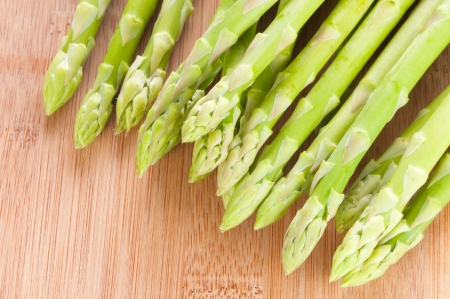 Fresh green Asparagus bundle on wooden background photo