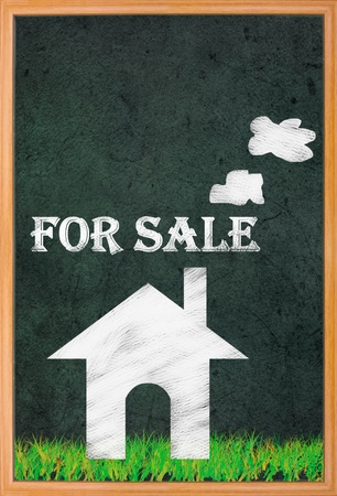 House for sale, drawing on retro blackboard. photo